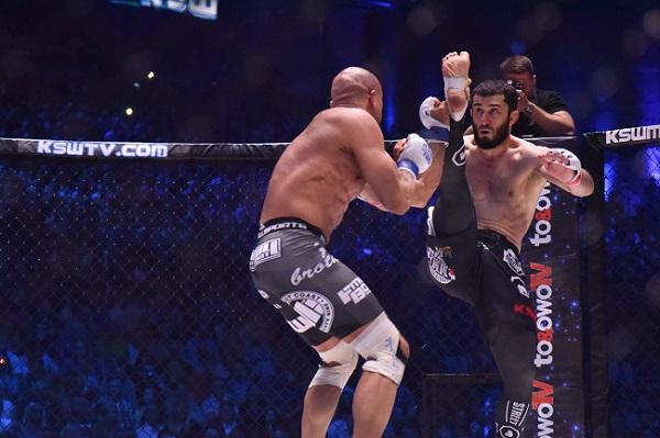 Khalidov attempts an axe-kick vs. Karaoglu (photo via KSW)